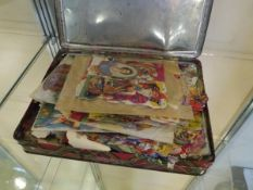 A tin of vintage scraps