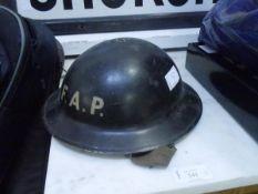 A World War II First Aid Post tin helmet