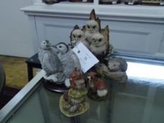 A group of Border Fine Arts and similar models comprising: three owl chicks; Country Artists two