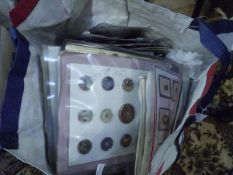 A bag containing a large group of vintage and antique buttons