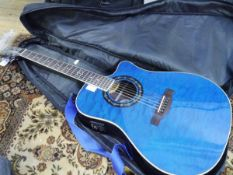 A Fender T-bucket 300CE teal bodied electric acoustic guitar