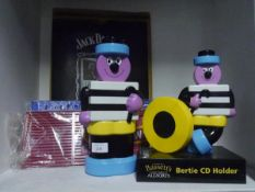 A group of advertising wares including Bassetts Allsorts CD holder
