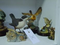 Four Border Fine Arts models: Robin and Chicks (Russell Willis); another bird model and two
