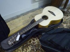 A Patrick James Eggle Spruce and mahogany travel acoustic guitar, in carrying case