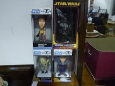 Four boxed Star Wars Bobble-Head figures, Anakin Skywalker, General Grievous, Princess Leia and