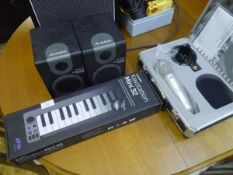 A group of music recording equipment including M audio mini 32 keystation, Alesis M1 active 320