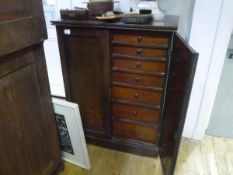 A Victorian mahogany collector's cabinet, the rectangular top above a pair of panelled doors