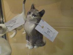 A Royal Copenhagen porcelain model of a seated grey cat, no. 1759/1803