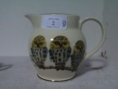 A large Emma Bridgewater jug painted with owls perched on a branch, marked for the Bridgewater