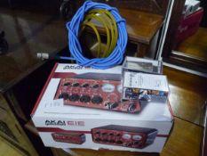 An Akai Professional 16-bit Electromusic Interface Expander, guitar bridges, cables etc