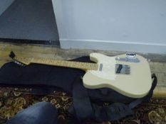A Fender coffee coloured Telecaster guitar in carrying case