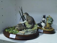 Two Border Fine Arts groups: A Long Day Ahead (sheepdogs), on an oval plinth; and Point of
