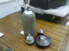 A vintage Sparklets wire-wrapped soda syphon; together with three vintage table lighters including
