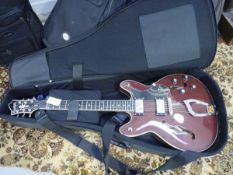 A Hagstrom Viking Semi Hollowbody electric guitar, wild cherry colourway in Hagstrom branded case