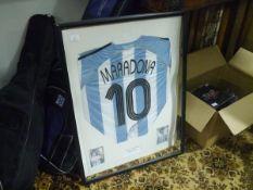Diego Maradona (Argentina): a reproduction no. 10 shirt, signed, framed and glazed.