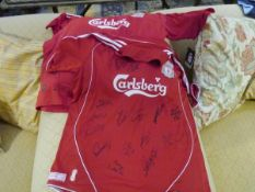 Two Liverpool F.C. home shirts, signed
