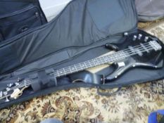 An Ibanez Gio series black gloss bass guitar, in travel bag