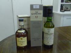 Three Scotch malt whiskies: Dalwhinnie single malt, 15 years old, boxed; Tullibardine, single