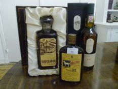 Three Scotch whiskies: Knockando Extra Old pure single malt, boxed with presentation label;