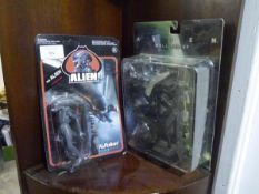 Two boxed fantasy figures from Alien, Reaction figures, one a wall relief (PBM)