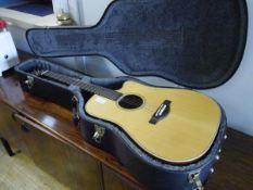 A Yahama elector acoustic guitar in flight case