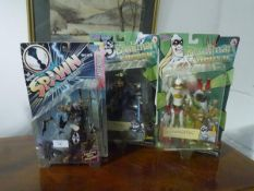 Three boxed fantasy figures, Suzanne the Orangutan from Chronic, Zombie Spawn and Bluntman, two