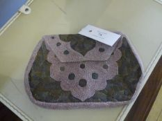 A vintage beadwork and needlework evening bag, with geometric decoration.