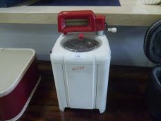 A Vulcan toy washing machine and mangle.