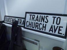 Two enamel road signs