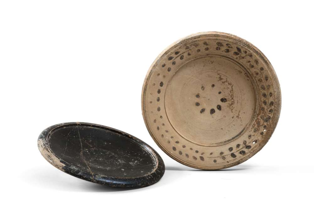TWO SOUTH-ITALIAN DISHES, 6TH-5TH CENTURY B.C. in clay, a shining black varnish and sovraddipinto.