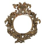 A RARE GILDED WOOD FRAME, PERIOD OF THE BAROCCHETTO to oval order, graven to leaves of acanthus