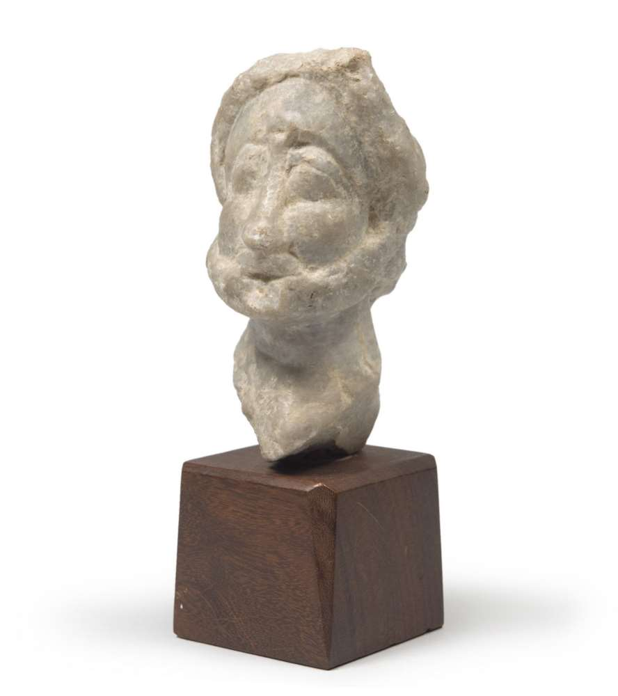 SMALL MARBLE SCULPTURE, NON DEFINABLE EPOCH representing head of man. Measures cm. 13 x 6 x 9.