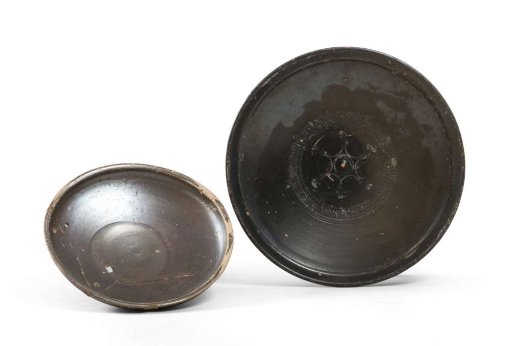 TWO ETRUSCAN BLACK-GLAZED DISHES, 6TH-5TH CENTURY B.C. in clay and shining black glaze. Tub with