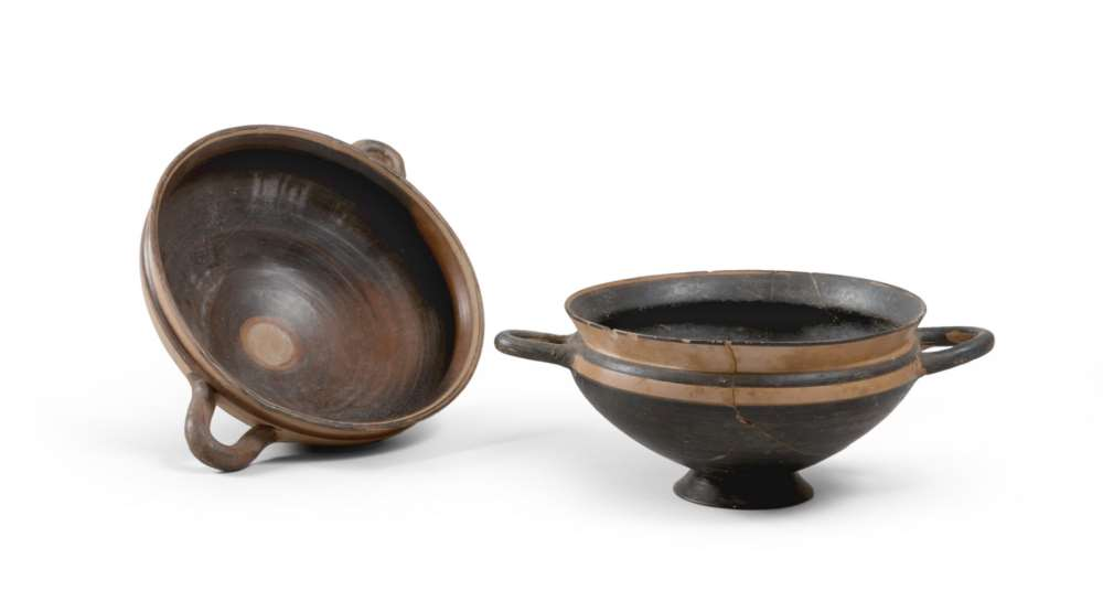 TWO IONIC CUPS, LATE 6T, EARLY 5TH CENTURY B.C. in clay, yellow glaze and brown varnish. Tub with