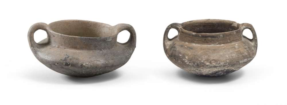 TWO ETRUSCAN VASES, 8TH-7TH CENTURY B.C. purified brown polished to stick. Hem to separate smooth