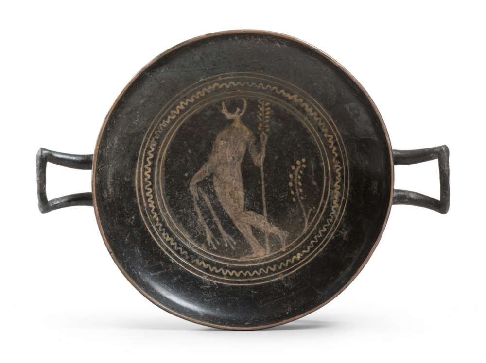 ETRUSCAN KYLIX OF THE GROUP OF THE GHOST, 4TH CENTURY B.C. in clay and opaque black glaze, with