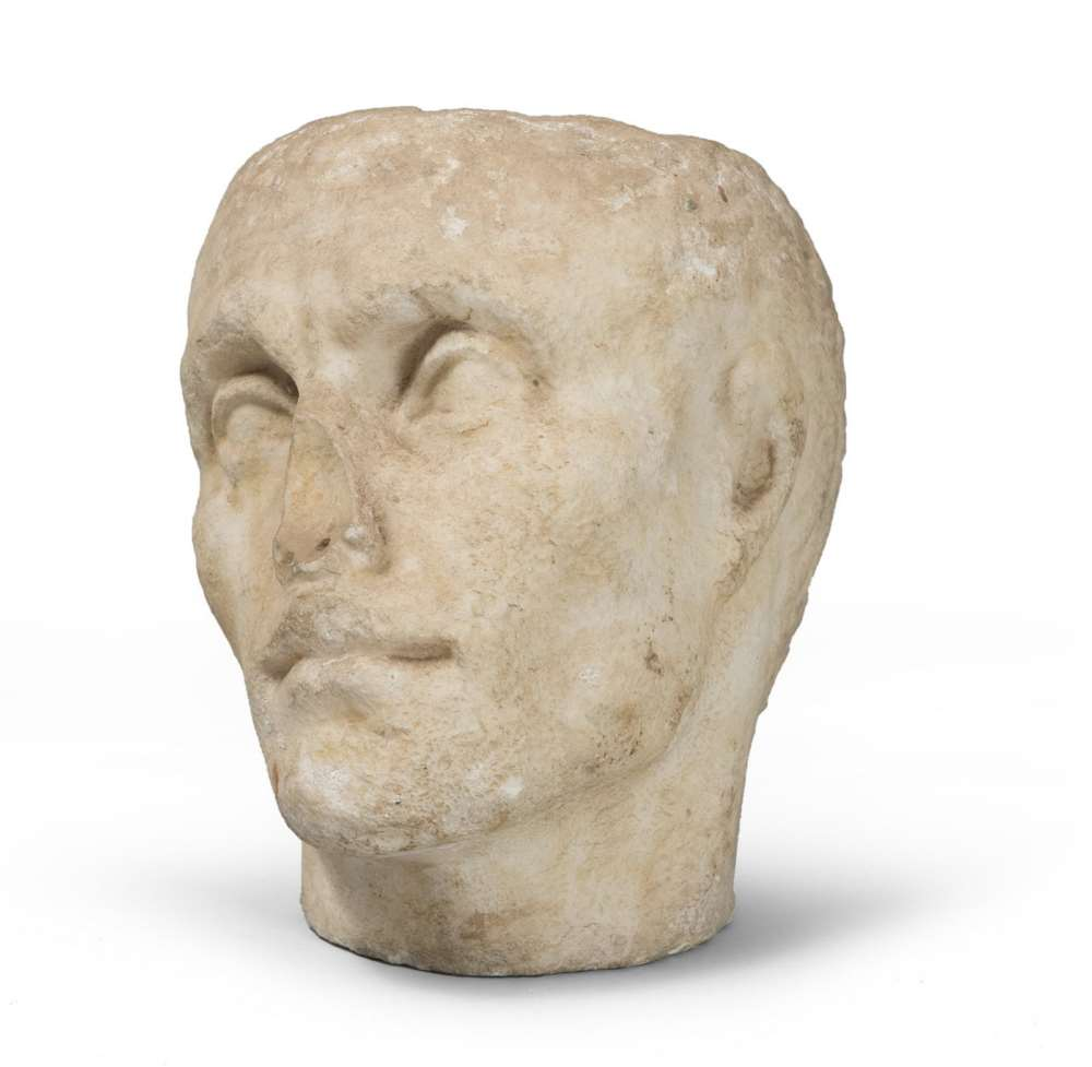 MALE PORTRAIT IN WHITE MARBLE, 1ST CENTURY B.C. with head slightly tilted toward right and hair