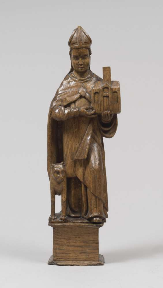 OAK WOOD SCULPTURE, FRANCE 17TH CENTURY representing figure of Saint with model of Church and dog.