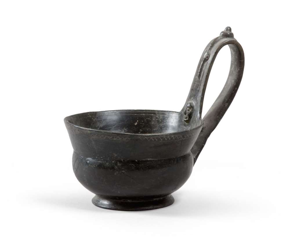 ETRUSCAN HANDLED CUP, 7TH CENTURY B.C. bucchero black polished stick. Smooth top and flared hem
