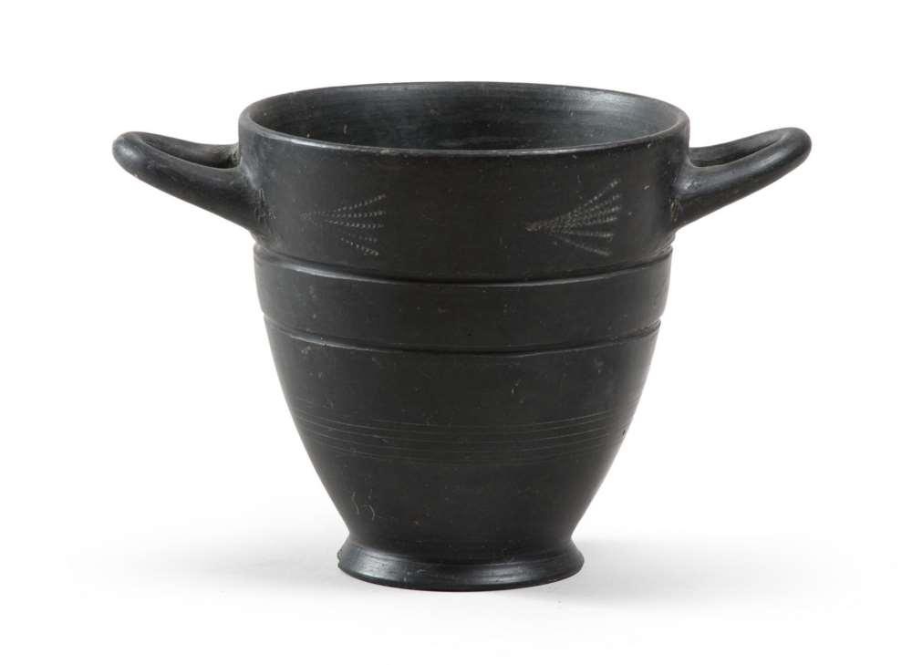 ETRUSCAN SKYPHOS, 7TH CENTURY B.C. bucchero black polished stick. indistinct smooth vertical rim,