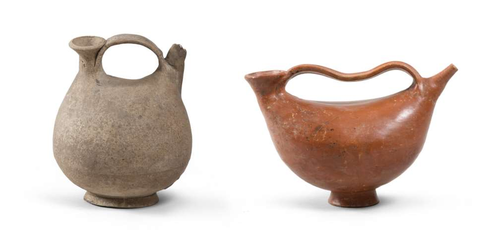 TWO ASKOI, 1ST CENTURY A.D. achromatic in ceramic, one with orange paint. Bodies with stylized