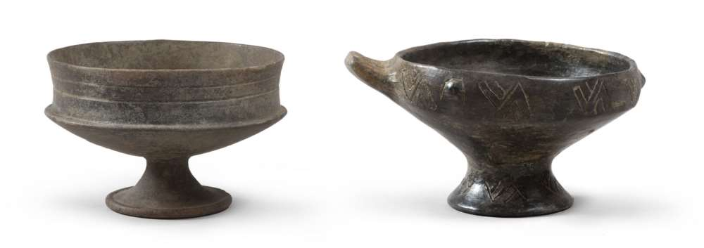 ETRUSCAN CALYX AND HANDLED-CUP, 8TH-6TH CENTURY B.C. Purified brown earthenware polished stick.