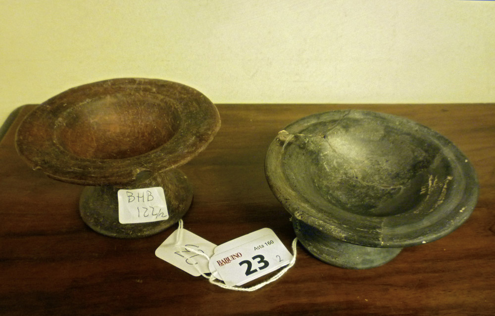 TWO ETRUSCAN DISHES, 7TH-6TH CENTURY B.C. earthenware purified brown polished to stick. Edge grooved