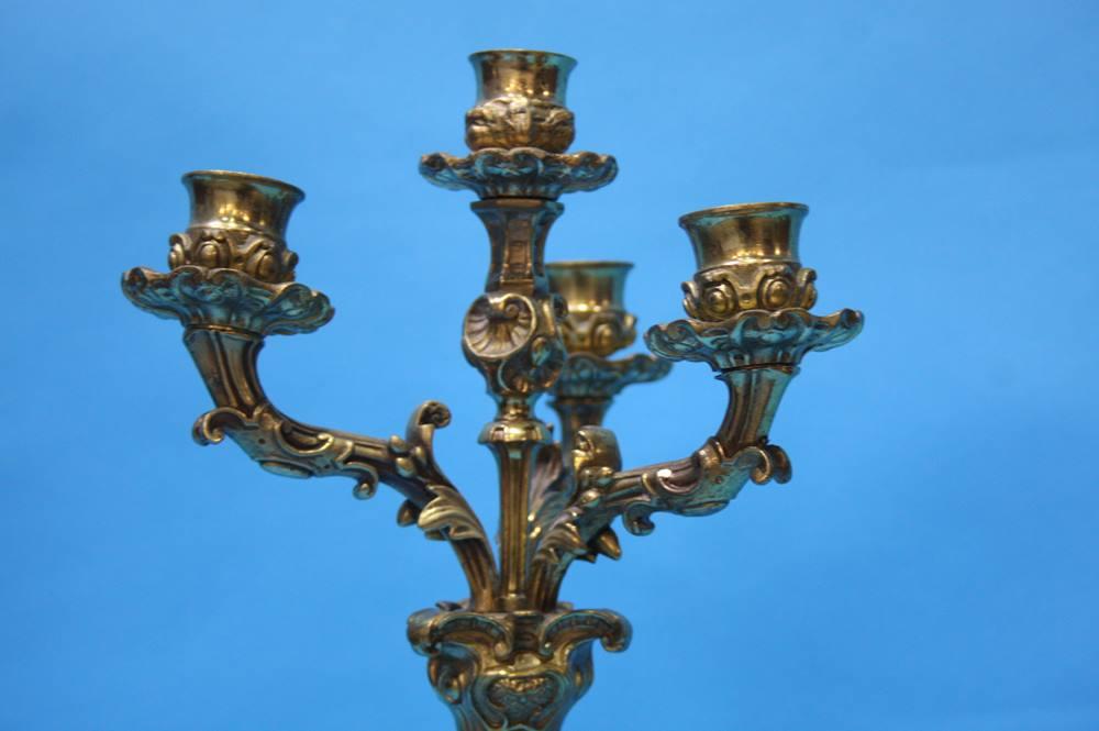 Lot 25 - A brass four sconce candelabra