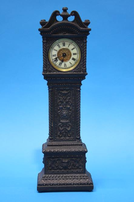 Lot 32 - A small metalware long case clock by Ansonin Clock