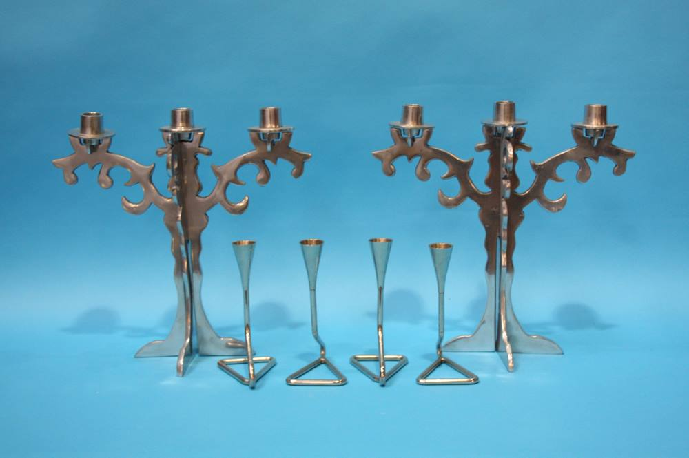 Lot 55 - A set of four Chrome candlesticks and a pair of aluminium 3 sconce candelabra