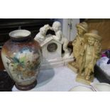 Various plaster figures and a glass vase