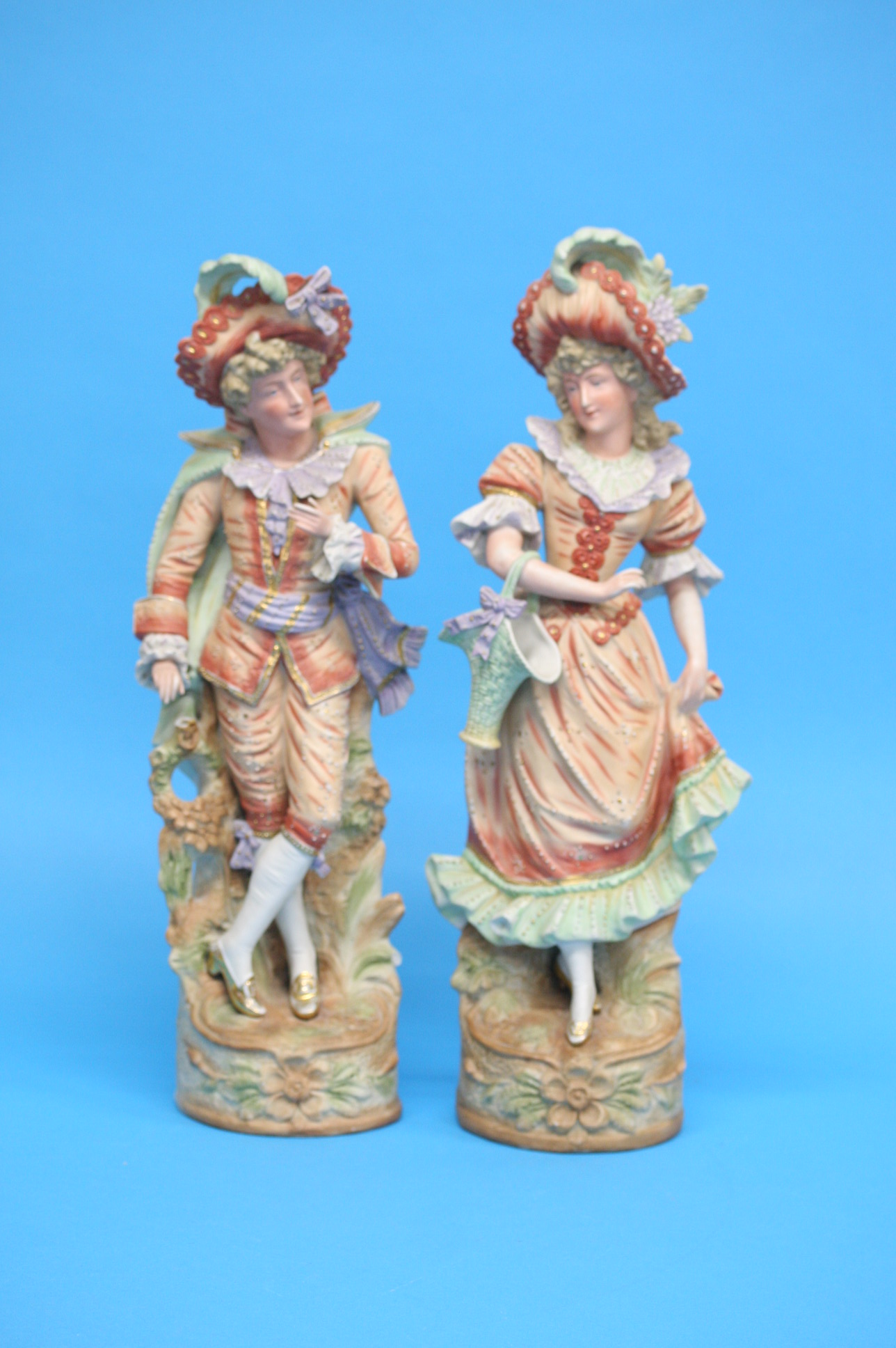 A pair of continental bisque figures of a gallant