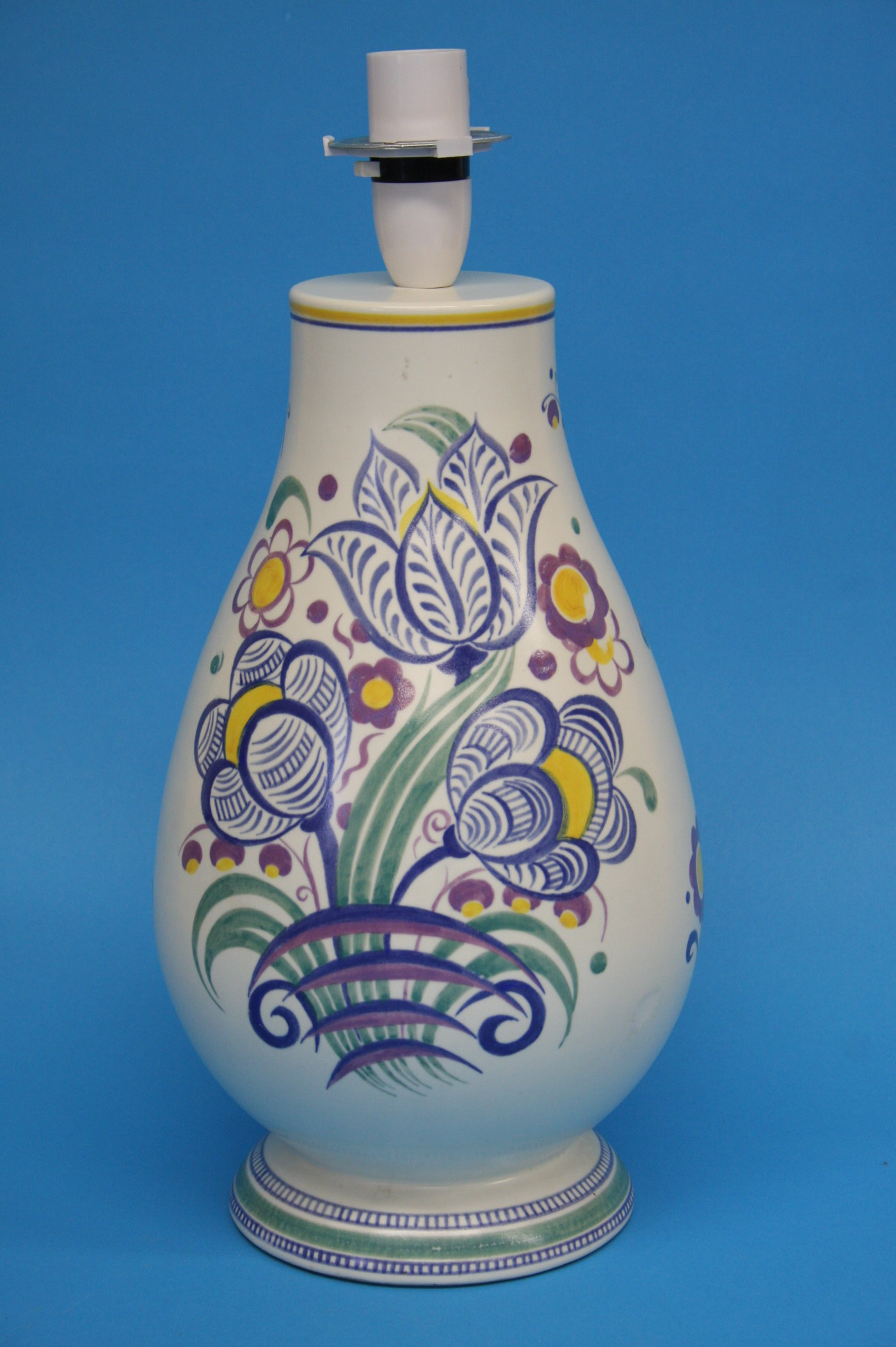 A Poole pottery baluster shaped table lamp decorat
