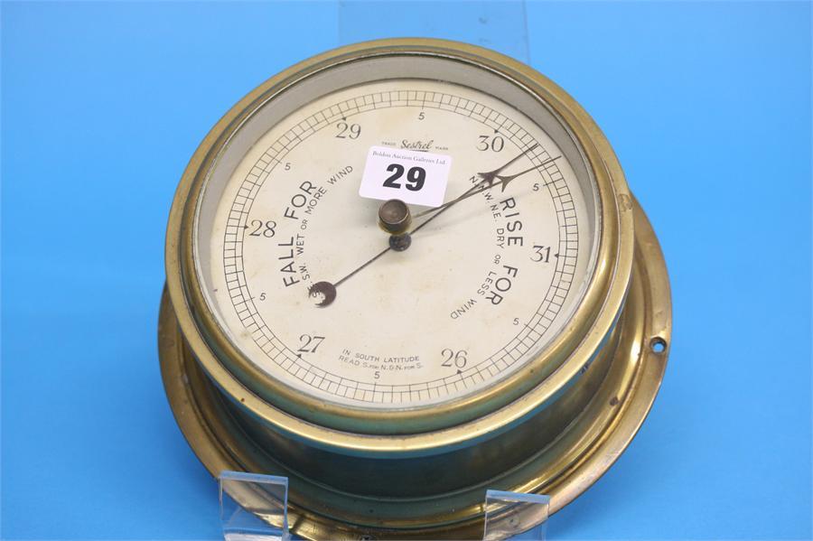 A Sestral brass ships barometer, 14.5cm diameter d